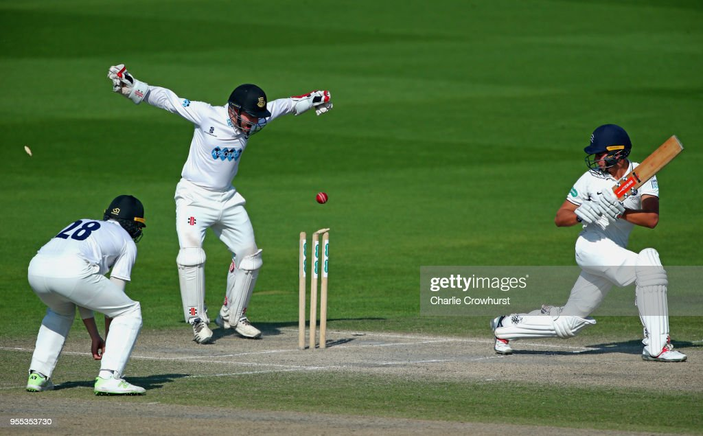 Max Holden of Middlesex looks on as he is bowled out as Ben Brown of Sussex celebrates during day three of the Specsavers County Championship: Division Two match between Sussex and Middlesex at The 1st Central County Ground on May 6, 2018 in Hove, England.