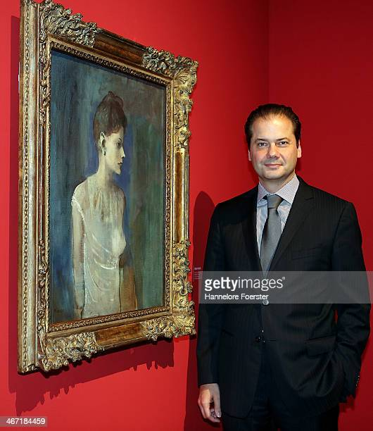 Max Hollein with the painting of Pablo Picasso at the 'Esprit Mont Martre' exhibition at Schirn Kunsthalle on February 6 2014 in Frankfurt am Main...