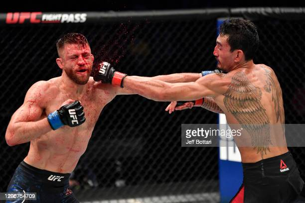 Max Holloway and Calvin Kattar trade punches in a featherweight bout during the UFC Fight Night event at Etihad Arena on UFC Fight Island on January...