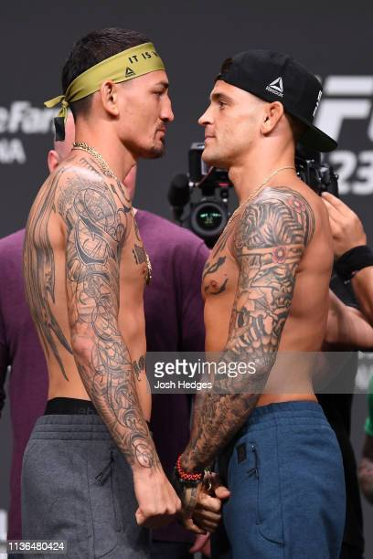 Max Holloway and Dustin Poirier face off during the UFC 236 weigh-in at State Farm Arena on April 12, 2019 in Atlanta, Georgia.