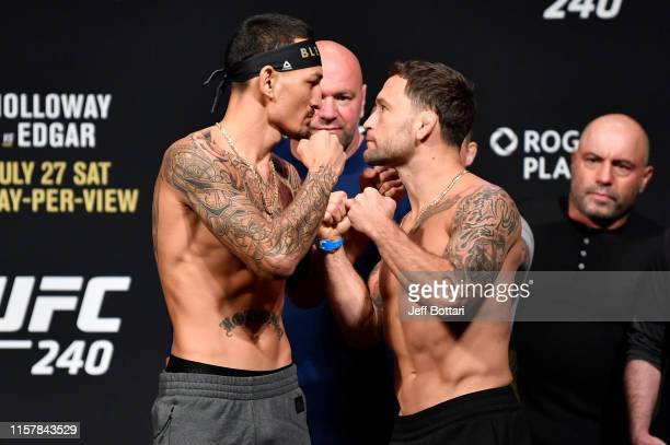 Max Holloway and Frankie Edgar face off during the UFC 240 weighin at Rogers Place on July 26 2019 in Edmonton Alberta Canada