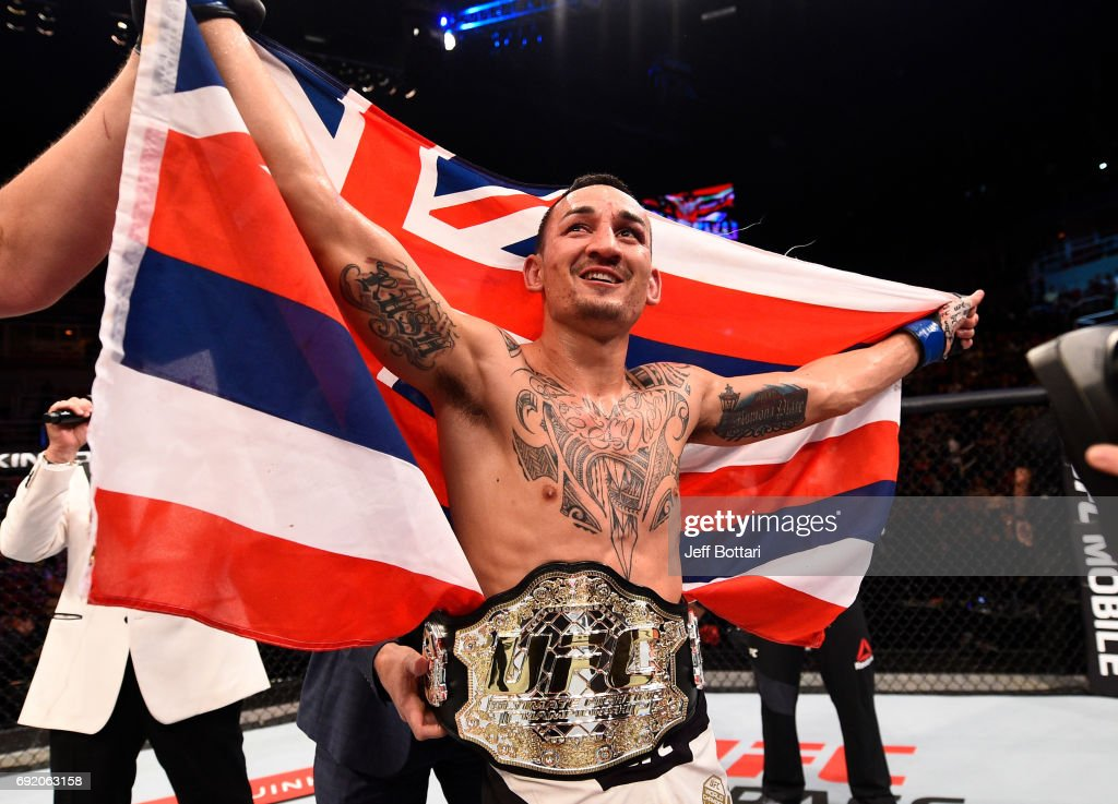 Max Holloway celebrates after his TKO victory over Jose Aldo of Brazil in their UFC featherweight championship bout during the UFC 212 event at Jeunesse Arena on June 3, 2017 in Rio de Janeiro, Brazil.