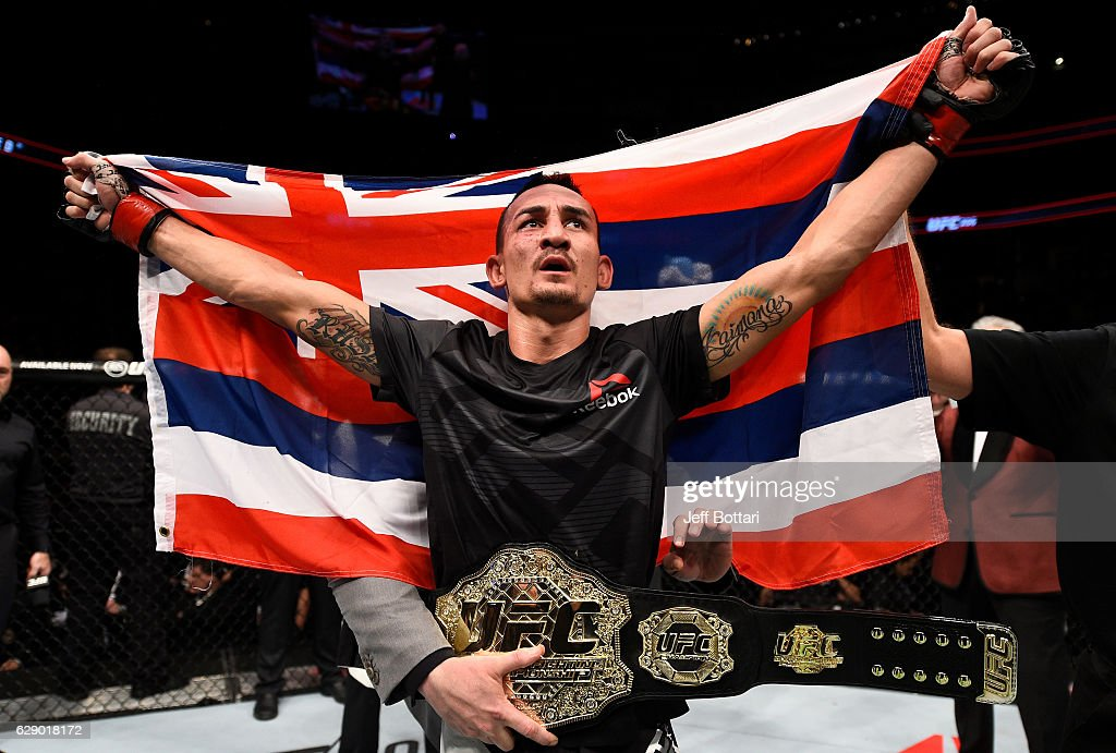 Max Holloway celebrates his TKO victory over Anthony Pettis in their interim UFC featherweight championship bout during the UFC 206 event inside the Air Canada Centre on December 10, 2016 in Toronto, Ontario, Canada.