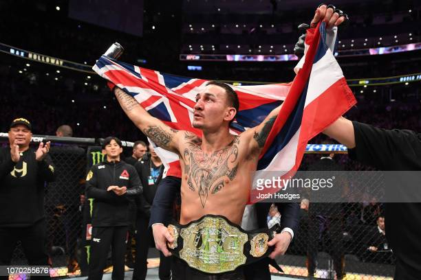Max Holloway celebrates his victory over Brian Ortega in their UFC featherweight championship fight during the UFC 231 event at Scotiabank Arena on...