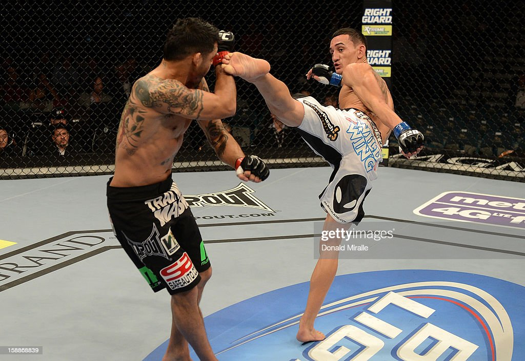 Max Holloway kicks Leonard Garcia during their featherweight fight at UFC 155 on December 29, 2012 at MGM Grand Garden Arena in Las Vegas, Nevada.