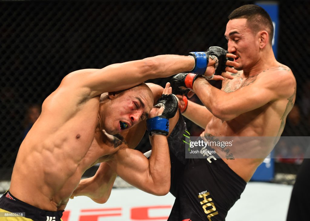 Max Holloway lands a knee against Jose Aldo of Brazil in their UFC featherweight championship bout during the UFC 218 event inside Little Caesars Arena on December 02, 2017 in Detroit, Michigan.