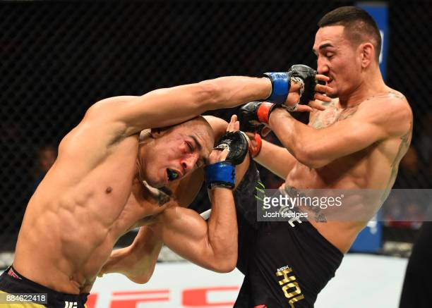 Max Holloway lands a knee against Jose Aldo of Brazil in their UFC featherweight championship bout during the UFC 218 event inside Little Caesars...