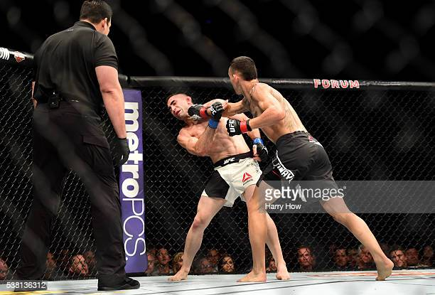 Max Holloway lands a right punch to Ricardo Lamas in their featherweight bout during the UFC 199 event at The Forum on June 4 2016 in Inglewood...
