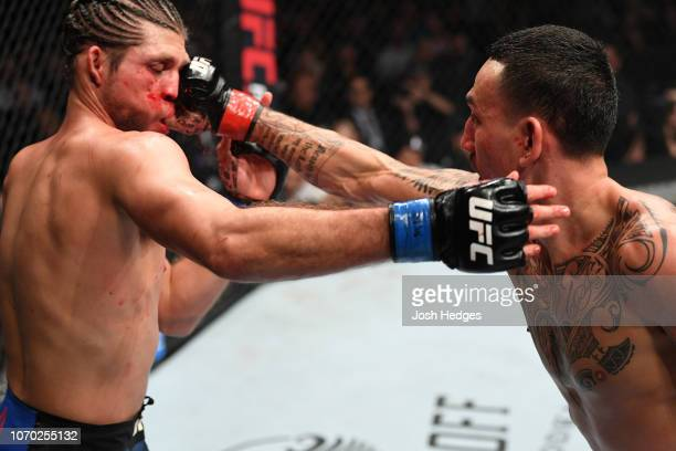 Max Holloway punches Brian Ortega in their UFC featherweight championship fight during the UFC 231 event at Scotiabank Arena on December 8, 2018 in...