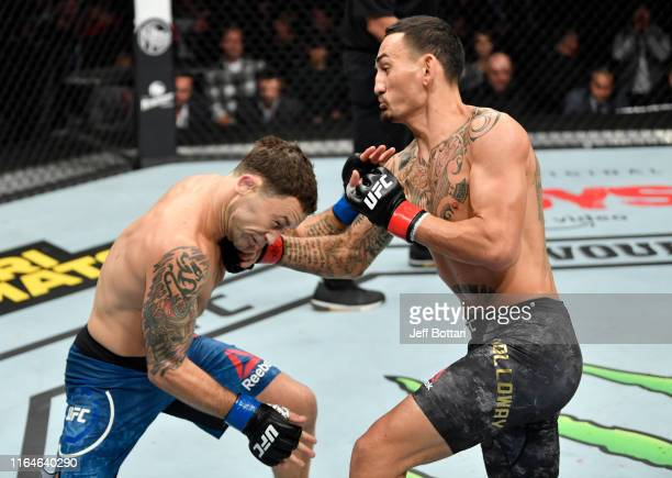 Max Holloway punches Frankie Edgar in their UFC featherweight championship bout during the UFC 240 event at Rogers Place on July 27 2019 in Edmonton...