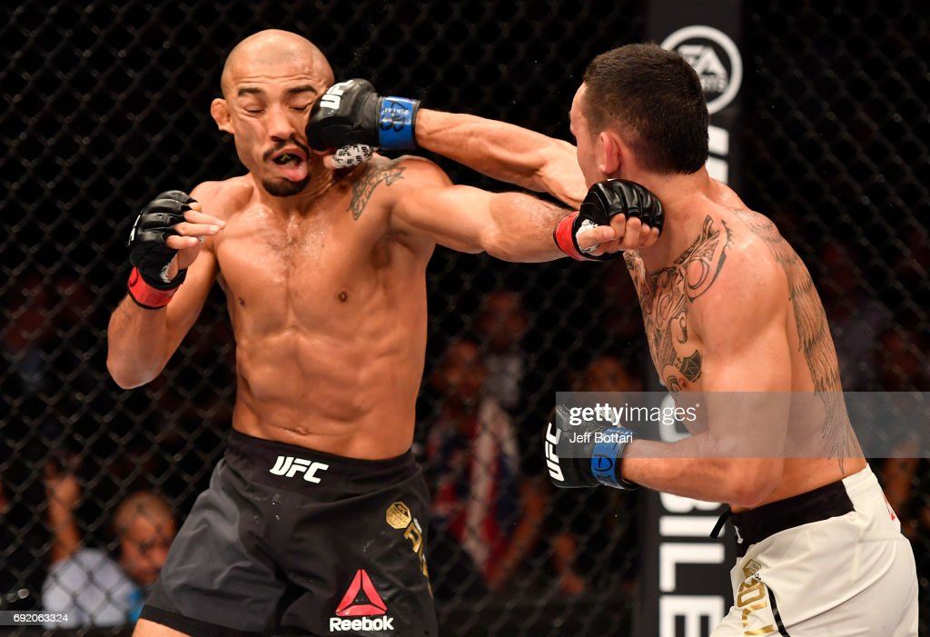 Max Holloway punches Jose Aldo of Brazil in their UFC featherweight championship bout during the UFC 212 event at Jeunesse Arena on June 3, 2017 in Rio de Janeiro, Brazil.