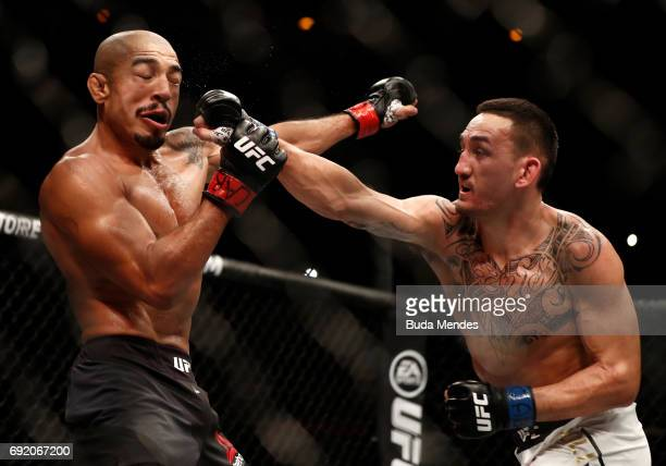 Max Holloway punches Jose Aldo of Brazil in their UFC featherweight championship bout during the UFC 212 event at Jeunesse Arena on June 3 2017 in...