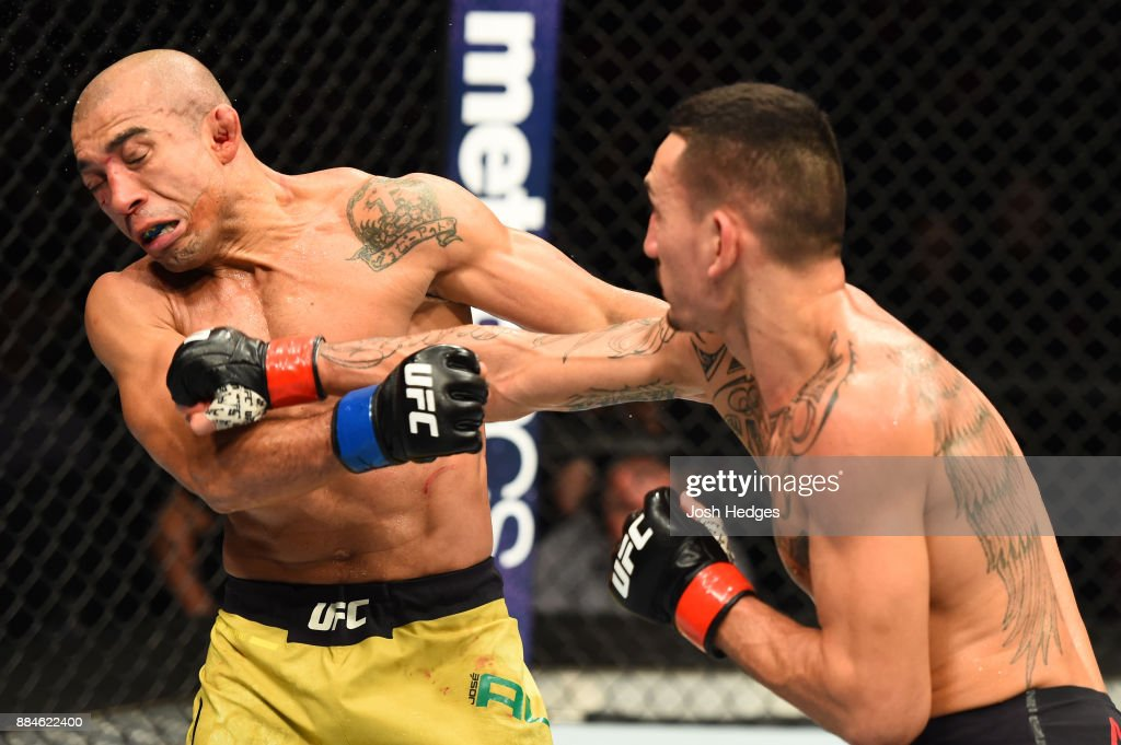 Max Holloway punches Jose Aldo of Brazil in their UFC featherweight championship bout during the UFC 218 event inside Little Caesars Arena on December 02, 2017 in Detroit, Michigan.