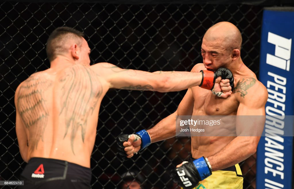 max holloway punches jose aldo of brazil in their ufc featherweight picture id884622410
