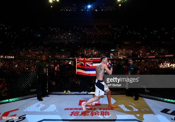 Max Holloway stands in the Octagon prior to his UFC featherweight championship bout against Jose Aldo of Brazil during the UFC 212 event at Jeunesse...
