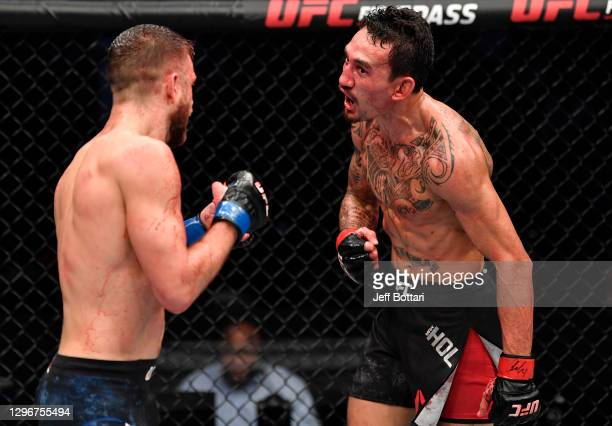 Max Holloway taunts Calvin Kattar in a featherweight bout during the UFC Fight Night event at Etihad Arena on UFC Fight Island on January 17, 2021 in...