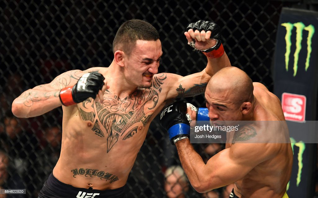 Max Holloway throws an elbow against Jose Aldo of Brazil in their UFC featherweight championship bout during the UFC 218 event inside Little Caesars Arena on December 02, 2017 in Detroit, Michigan.