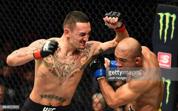 Max Holloway throws an elbow against Jose Aldo of Brazil in their UFC featherweight championship bout during the UFC 218 event inside Little Caesars...