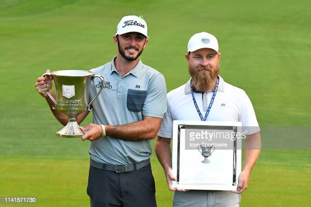 Max Homa and his caddie Joe Greiner pose for a photo with their trophies after winning the Wells Fargo Championship on May 05 2019 at Quail Hollow...