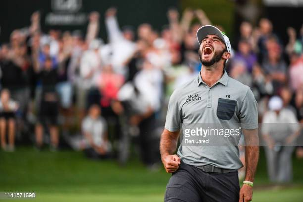 Max Homa celebrates as he sinks the winning putt on the eighteenth green during the final round of the Wells Fargo Championship at Quail Hollow Club...
