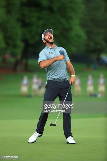 Max Homa celebrates on the 18th green after making his par putt to win the 2019 Wells Fargo Championship at Quail Hollow Club on May 05 2019 in...