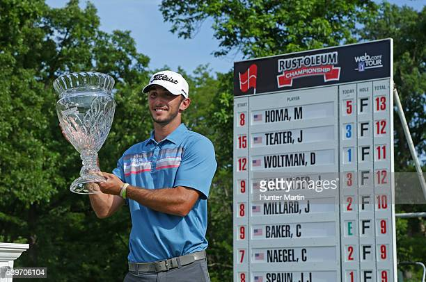 Max Homa holds the championship trophy after winning the Webcom Tour RustOleum Championship at the Ivanhoe Club on June 12 2016 in Ivanhoe Illinois