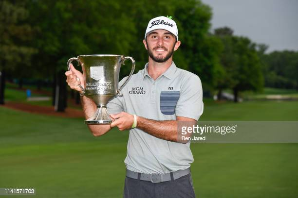 Max Homa holds the Wells Fargo Championship trophy on the eighteenth green after the final round of the Wells Fargo Championship at Quail Hollow Club...
