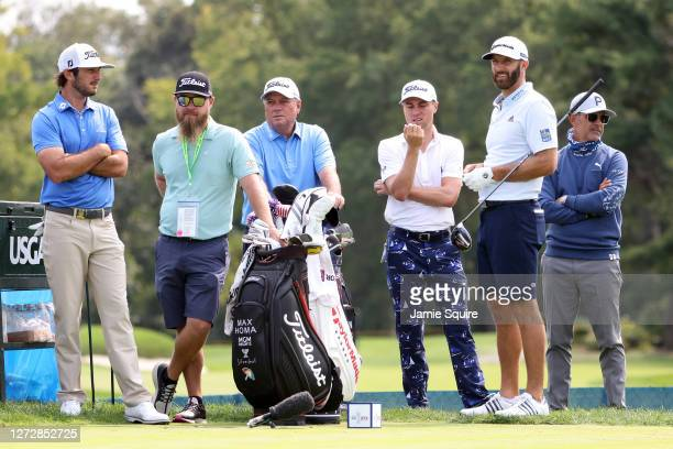 Max Homa of the United States, Justin Thomas of the United States and Dustin Johnson of the United States look on from the second tee during a...