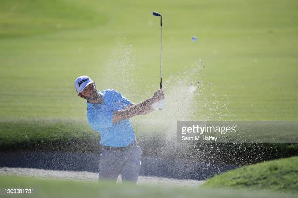 Max Homa of the United States plays a shot from a bunker on the 17th hole during the final round of The Genesis Invitational at Riviera Country Club...