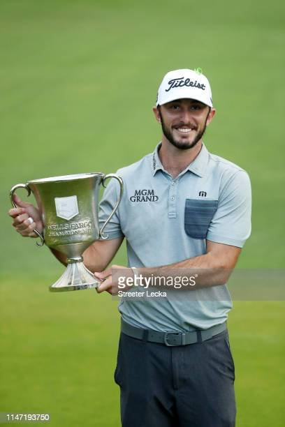 Max Homa poses with the trophy after winning the 2019 Wells Fargo Championship at Quail Hollow Club on May 05 2019 in Charlotte North Carolina