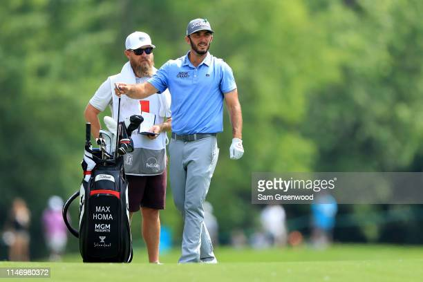 Max Homa pulls a club from his bag on the ninth hole as his caddie Joe Greiner looks on during the third round of the 2019 Wells Fargo Championship...
