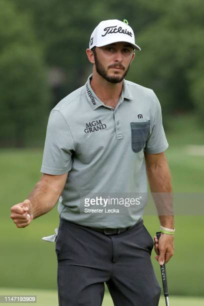 Max Homa reacts following his par putt on the 17th green during the final round of the 2019 Wells Fargo Championship at Quail Hollow Club on May 05...