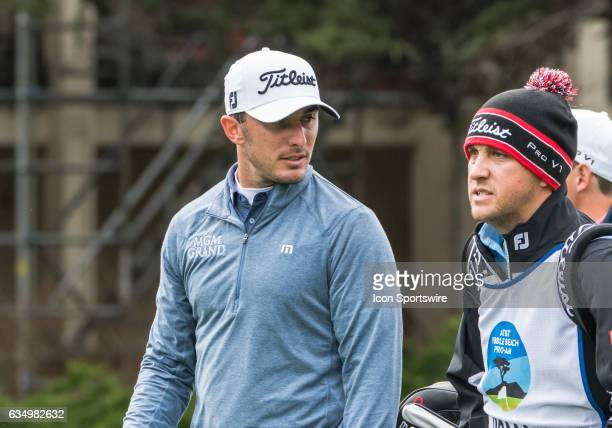 Max Homa talks with his caddy as they head down the fairway from the 1st tee during the second round of the ATT Pebble Beach ProAm in Pebble Beach CA...