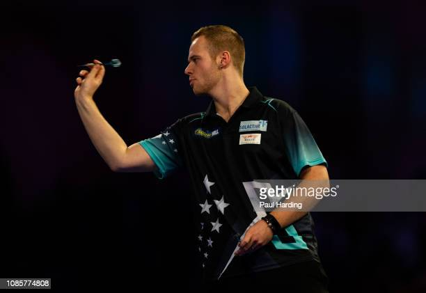 Max Hopp throws during his third round match against Michael van Gerwen during Day 10 of the 2019 William Hill World Darts Championship at Alexandra...