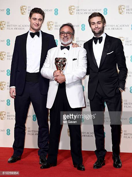 Max Irons Colin Gibson Winner of Best Production Design for 'Mad Max Fury Road' and Douglas Booth pose in the winners room at the EE British Academy...
