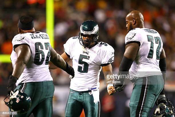 Max JeanGilles Donovan McNabb and Tra Thomas of the Philadelphia Eagles celebrate after McNabb threw a 22yard touchdwon pass to DeSean Jackson in the...