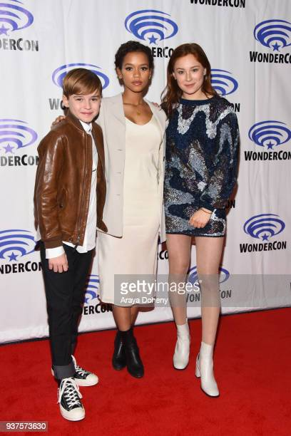 Max Jenkins Taylor Russell and Mina Sundwall attend the Lost in Space press conference at WonderCon 2018 Day 2 at Anaheim Convention Center on March...