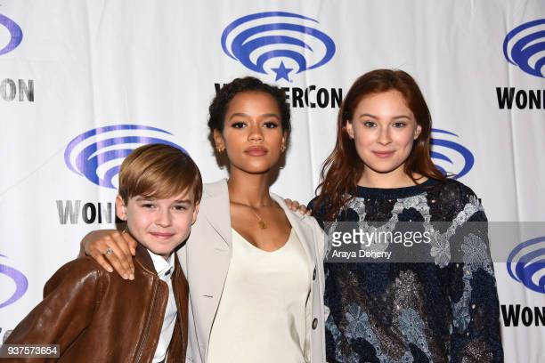 Max Jenkins Taylor Russell and Mina Sundwall attend the 'Lost in Space' press conference at WonderCon 2018 Day 2 at Anaheim Convention Center on...