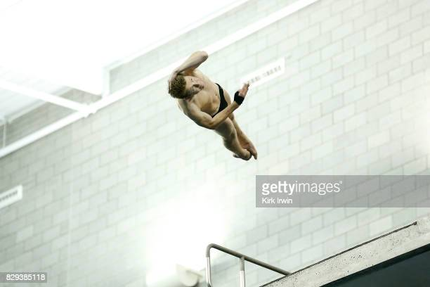 Max Jenkins twists while leaping off of the platform during the Senior Men's Platform Semifinal during the 2017 USA Diving Summer National...