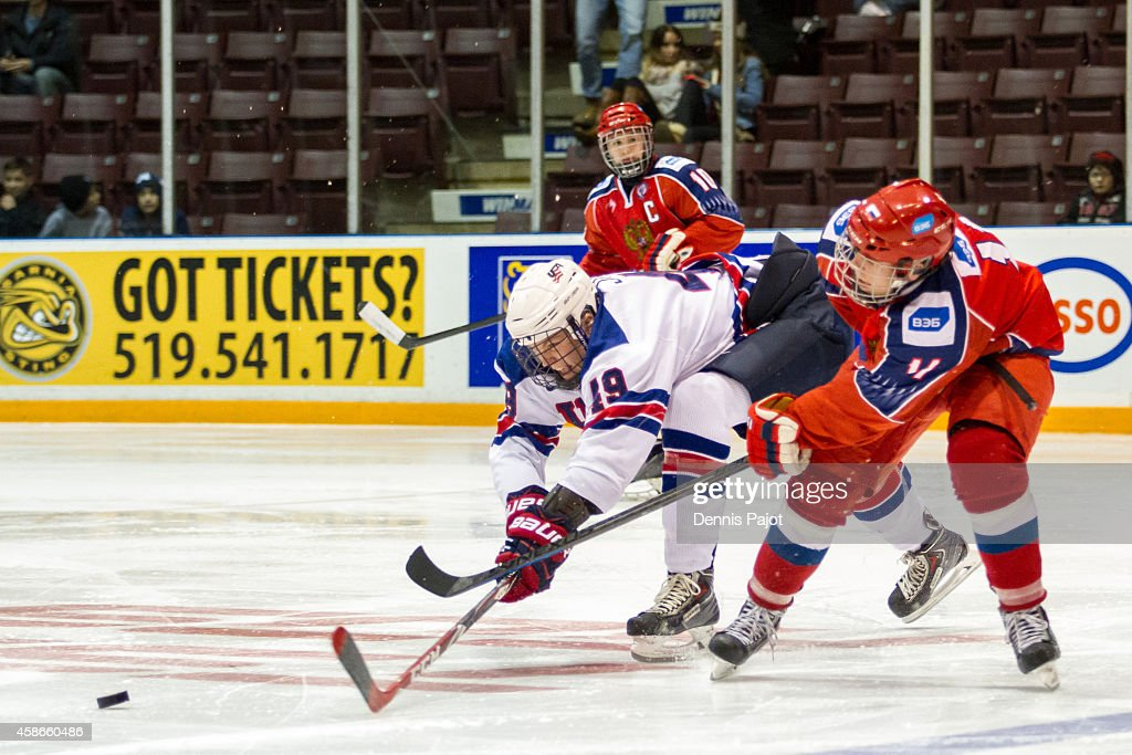 Max Jones #49 of the United States moves the puck against Vitali Abramov #11 of Russia during the gold medal game at the World Under-17 Hockey Challenge on November 8, 2014 at the RBC Centre in Sarnia, Ontario, Canada.
