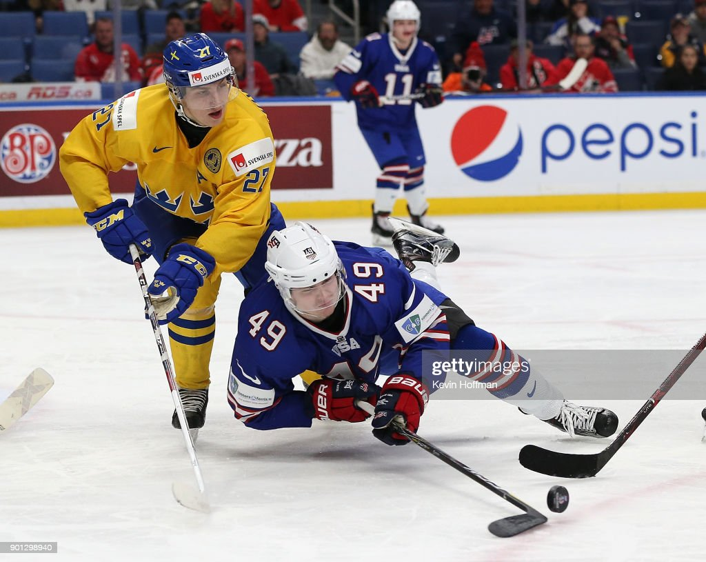 Max Jones #49 of United States tries to control the puck as Jacob Moverare #27 of Sweden defends in the second period during the IIHF World Junior Championship at KeyBank Center on January 4, 2018 in Buffalo, New York.