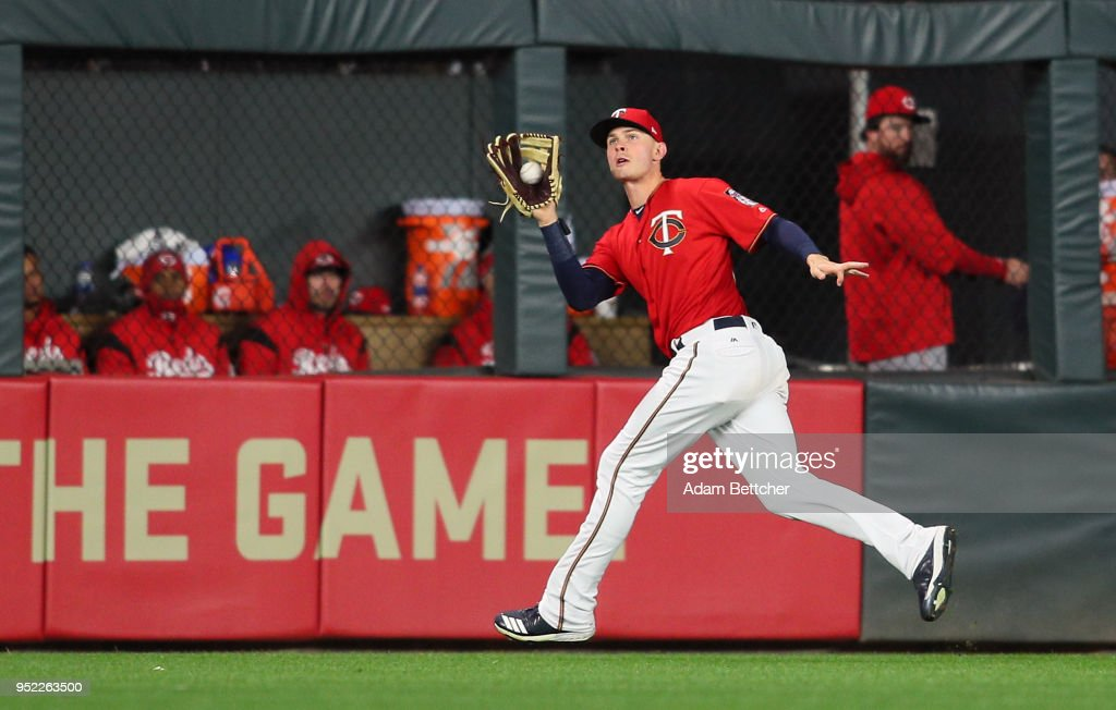 Max Kepler #26 of the Minnesota Twins catches a Jesse Winker #33 of the Cincinnati Reds pop fly in the ninth inning at Target Field on April 27, 2018 in Minneapolis, Minnesota. The Reds defeated the Twins 15-9.