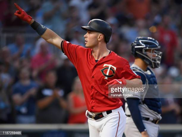 Max Kepler of the Minnesota Twins celebrates a solo home run as Gary Sanchez of the New York Yankees looks on during the fourth inning of the game on...