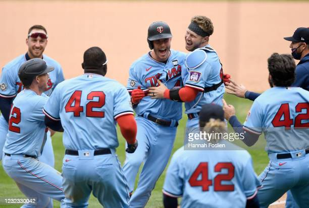 Max Kepler of the Minnesota Twins celebrates a walk-off single against the Boston Red Sox after the game at Target Field on April 15, 2021 in...