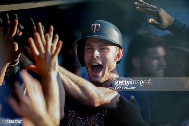 Max Kepler of the Minnesota Twins celebrates in the dugout after hitting a solo home run off starting pitcher Trevor Bauer of the Cleveland Indians...