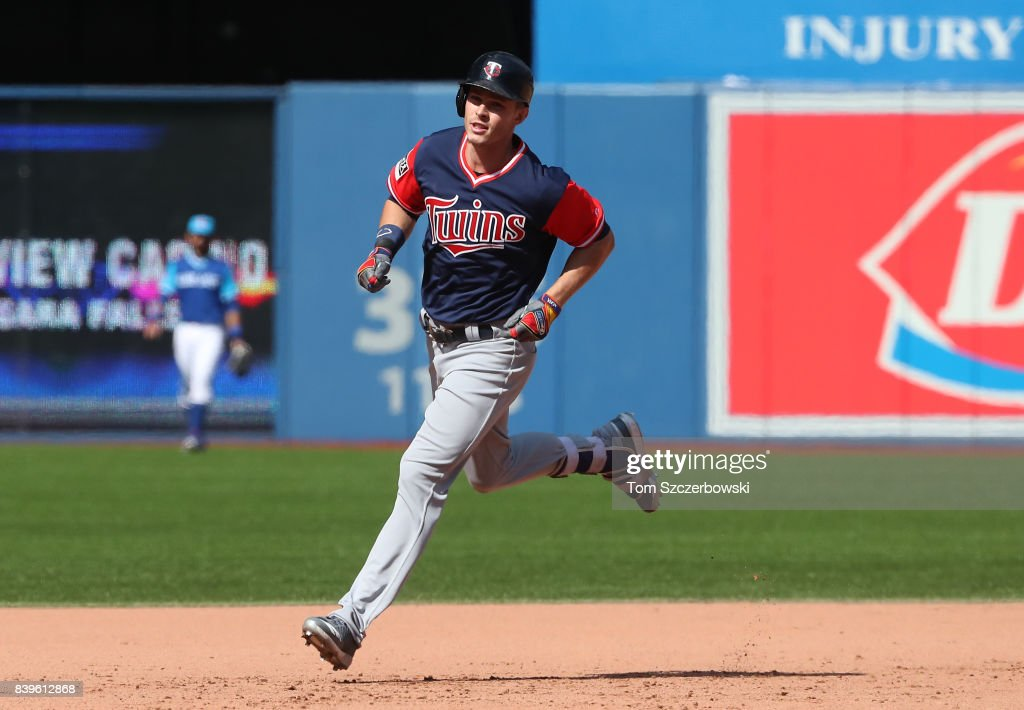 Max Kepler #26 of the Minnesota Twins circles the bases after hitting a grand slam home run in the eighth inning during MLB game action against the Toronto Blue Jays at Rogers Centre on August 26, 2017 in Toronto, Canada.