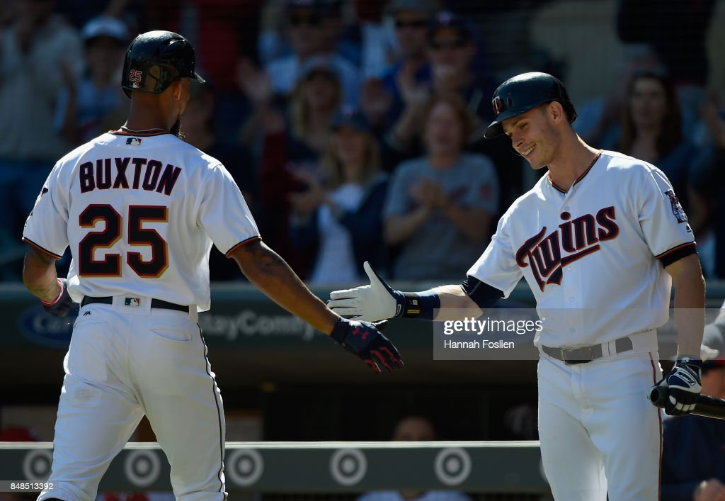 Max Kepler #26 of the Minnesota Twins congratulates teammate Byron Buxton #25 on solo home run against the Toronto Blue Jays during the second inning of the game on September 17, 2017 at Target Field in Minneapolis, Minnesota.