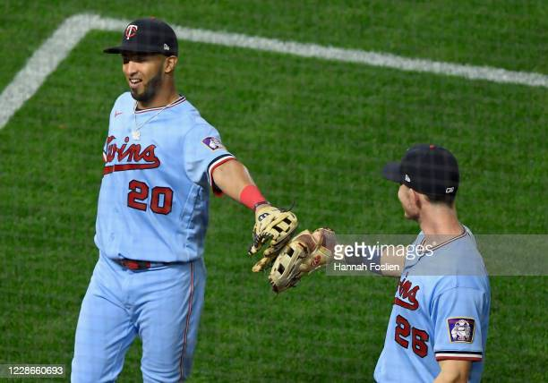 Max Kepler of the Minnesota Twins congratulates teammate Eddie Rosario on making a play in left field to get out the Daz Cameron of the Detroit...