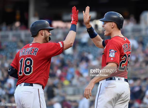 Max Kepler of the Minnesota Twins congratulates teammate Mitch Garver on a tworun home run against the Los Angeles Angels of Anaheim during the third...