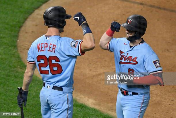 Max Kepler of the Minnesota Twins congratulates teammate Mitch Garver on a solo home run against the Detroit Tigers during the fourth inning of the...